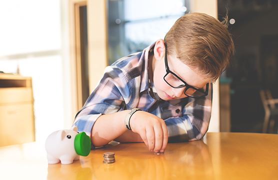 Boy counting his coins