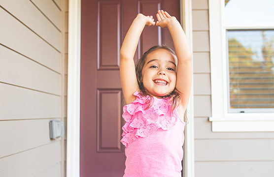 happy girl raising her arms