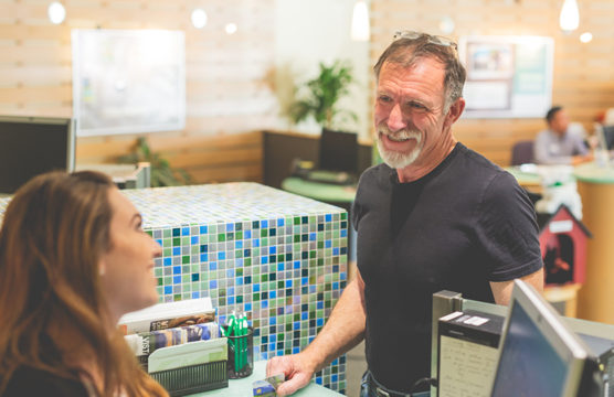 Bank teller smiling at an older man